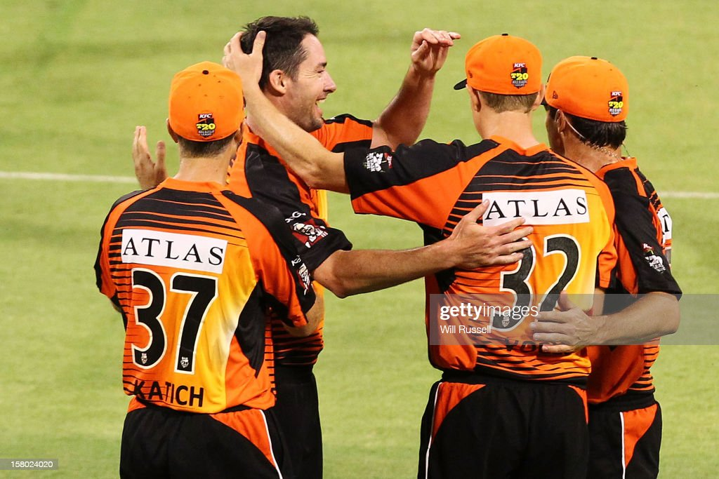 Scorchers players celebrate after taking the the wicket of Callum Ferguson of the Strikers during the Big Bash League match between the Perth Scorchers and Adelaide Strikers at WACA on December 9, 2012 in Perth, Australia.