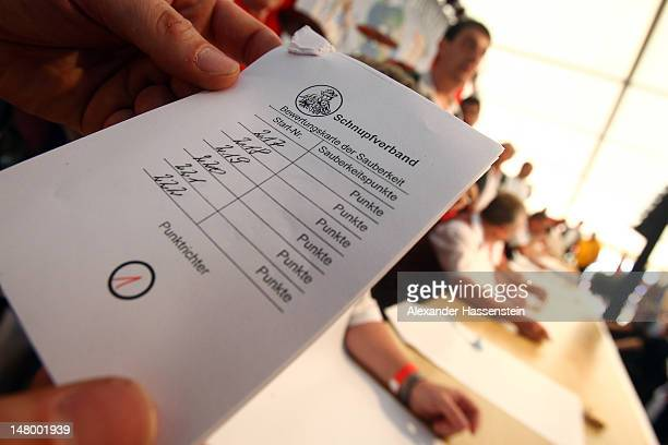 Score card is seen during 18th Snuff World Championships on July 7 2012 in Peutenhausen near Munich Germany 290 participants from Germany Austria the...