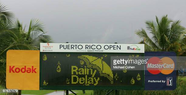 A scoreboard announces a rain delay during the first round of the Puerto Rico Open presented by Banco Popular at Trump International Golf Club held...
