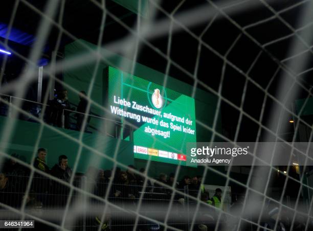 A scoreboard announcing the cancellation of the match is seen during heavy snow fall in Lotte Germany on February 28 2017 Sportfreunde Lotte and...