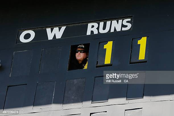 A scoreboard attendant looks on during day three of the second Test match between Australia and New Zealand at WACA on November 15 2015 in Perth...