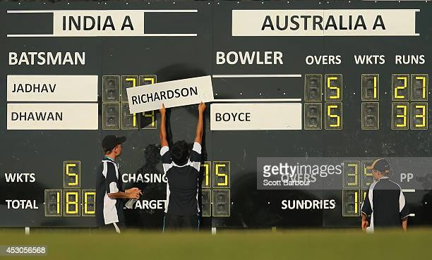 Scoreboard attendants adjust the score during the Cricket Australia Quadrangular Series Final match between Australia 'A' and India 'A' at Marrara...