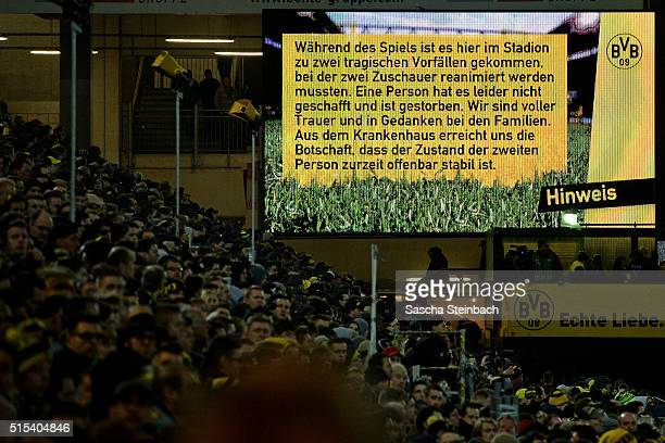 A scoreboard notes that one person died and another person has to be resuscitated during the Bundesliga match between Borussia Dortmund and 1 FSV...