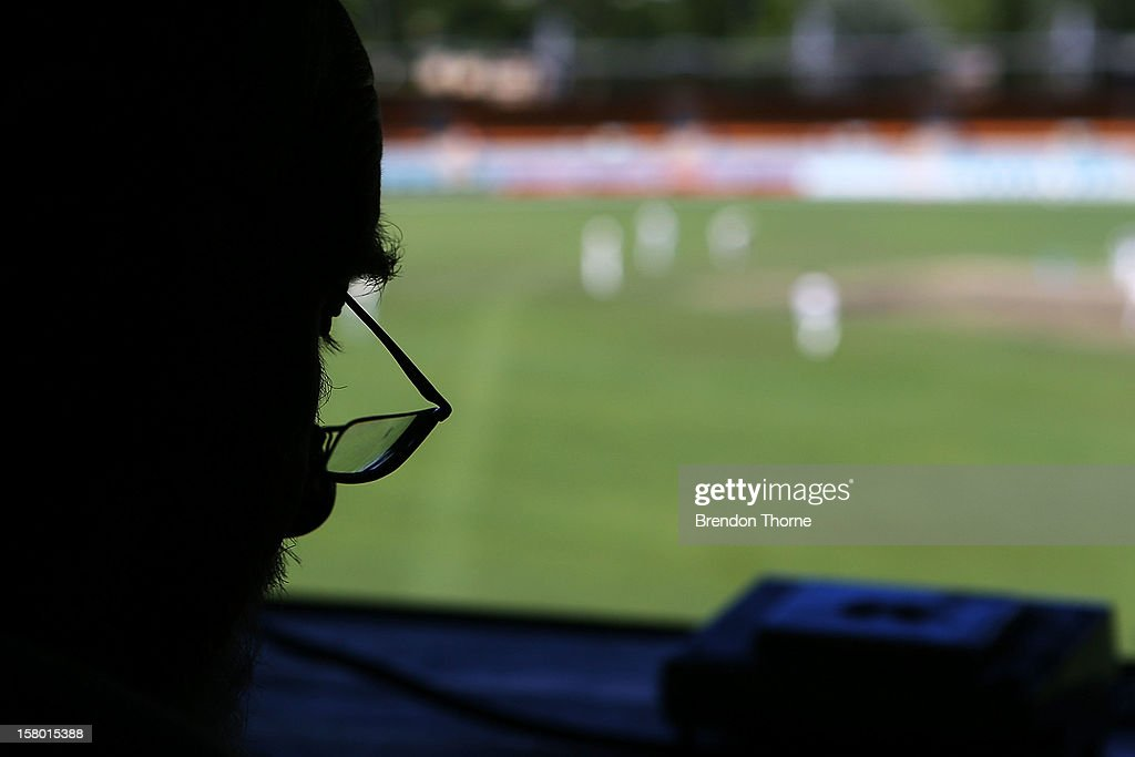 A scoreboard operator keeps score during an international tour match between the Chairman's XI and Sri Lanka from inside The Jack Fingleton Scoreboard at Manuka Oval on December 8, 2012 in Canberra, Australia. The Jack Fingleton Scoreboard was first erected at the MCG in 1901. In 1982 it was replaced by an electronic board and donated to the Manuka Oval by the Melbourne Cricket Club as memorial to J.H.W Fingleton OBE.