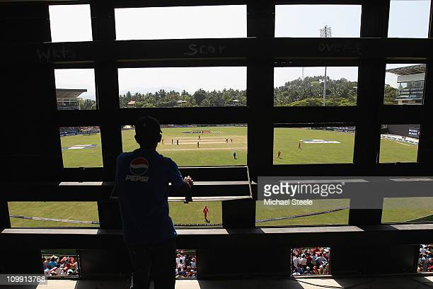 A scoreboard operator looks on during the Sri Lanka v Zimbabwe 2011 ICC World Cup Group A match at the Pallekele Cricket Stadium on March 10 2011 in...