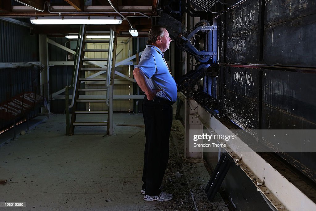 A scoreboard operator watches play during an international tour match between the Chairman's XI and Sri Lanka from inside The Jack Fingleton Scoreboard at Manuka Oval on December 8, 2012 in Canberra, Australia. The Jack Fingleton Scoreboard was first erected at the MCG in 1901. In 1982 it was replaced by an electronic board and donated to the Manuka Oval by the Melbourne Cricket Club as memorial to J.H.W Fingleton OBE.