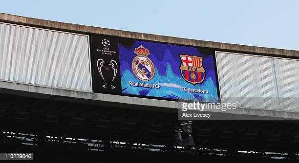 A scoreboard shows the badges of Real Madrid and Barcelona prior to the UEFA Champions League Semi Final first leg match between Real Madrid and...