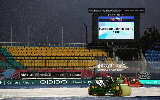 A scoreboard shows the match has been abandoned due to rain during the ICC World Twenty20 India 2016 match between Netherlands and Oman at the HPCA...