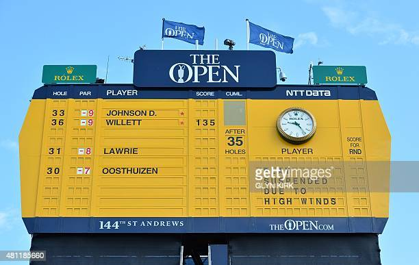 A scoreboard shows the suspension of play on the morning of the third day of 2015 British Open Golf Championship on The Old Course at St Andrews in...