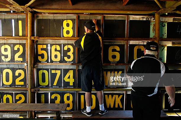 Scoreboard staff change the score plates in the old scoreboard during the One Day International match between Australia and South Africa at WACA on...