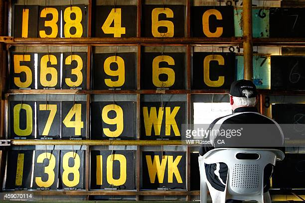 A scoreboard staff member watches the action from the old scoreboard during the One Day International match between Australia and South Africa at...