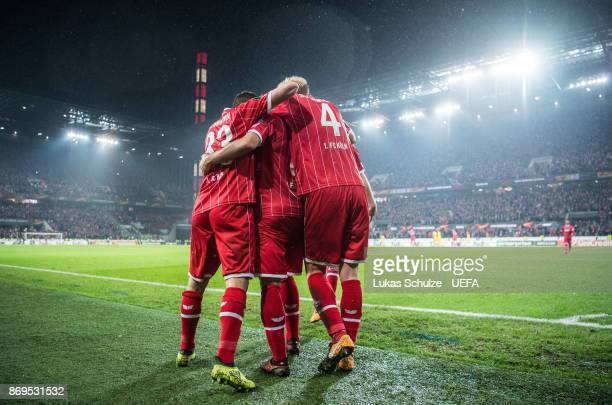 Scorer Milos Jojic celebrates his teams fifth goal with Matthias Lehmann and Frederik Soerensen during the UEFA Europa League group H match between 1...