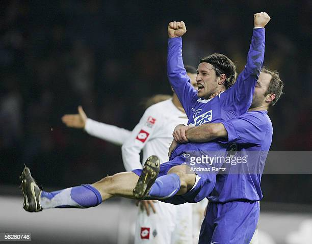 Scorer Niko Kovac celebrates with Dick van Burik of Berlin the fourth goal during the Bundesliga match between Hertha BSC Berlin and Borussia...
