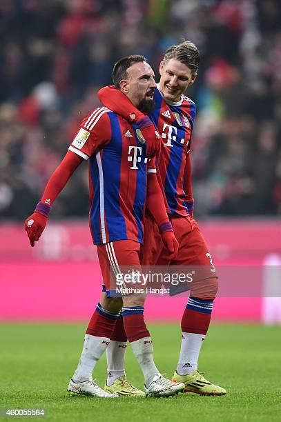 Scorer of the matchwinning goal Franck Ribery of Bayern Muenchen is congratulted by teammate Bastian Schweinsteiger of Bayern Muenchen following...