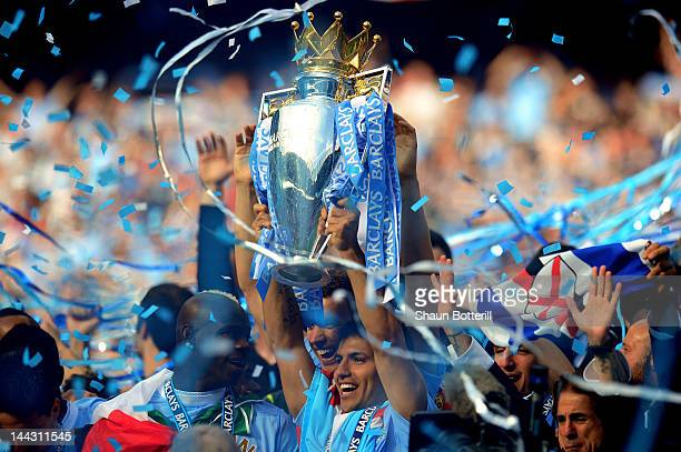 Scorer of the matchwinning goal Sergio Aguero of Manchester City celebrates with the trophy during the Barclays Premier League match between...