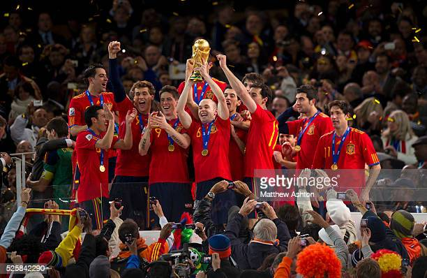 Scorer of the winning goal Andres Iniesta of Spain holds up the FIFA World Cup Trophy