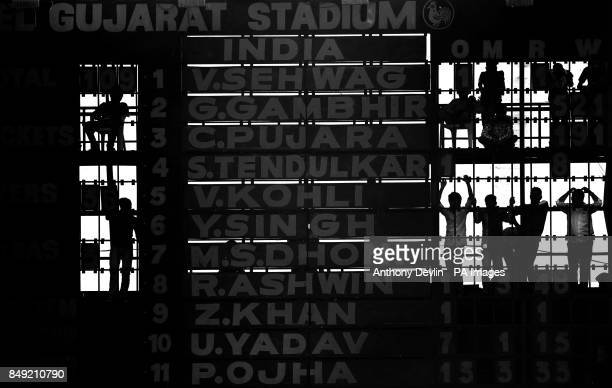 Scorers are seen behind the scoreboard during the third day of the first test match between India and England at the Sardar Patel Stadium in...