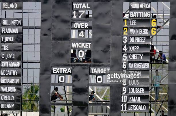 Scorers are seen through the score board during the ICC Women's world twenty20 match between South Africa Women and Ireland Women played at Sylhet...