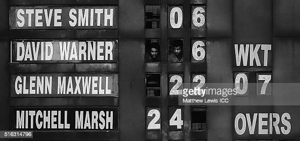 Scorers look on from the scoreboard during the ICC World Twenty20 India 2016 match between Australia and New Zealand at the HPCA Stadium on March 18...