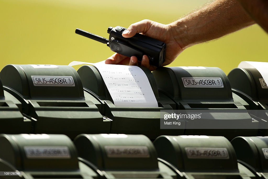 Scores are checked during the 500 yards Singles Full Bore Open at the CRPF Campus, Kadarpur during day seven of the Delhi 2010 Commonwealth Games on October 10, 2010 in Gurgaon, India.