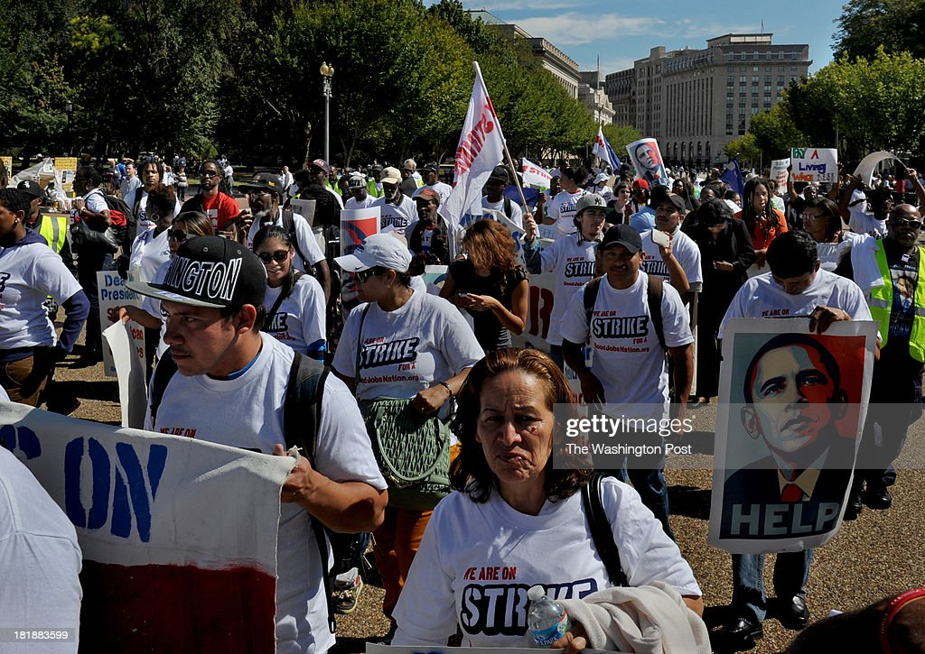 Scores of Federal workers and supporters marched from Freedom Plaza to Lafayette Park in front of the White House as part of a demonstration protesting low wages.