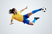soccer player kicking ball towards goal for score and glory