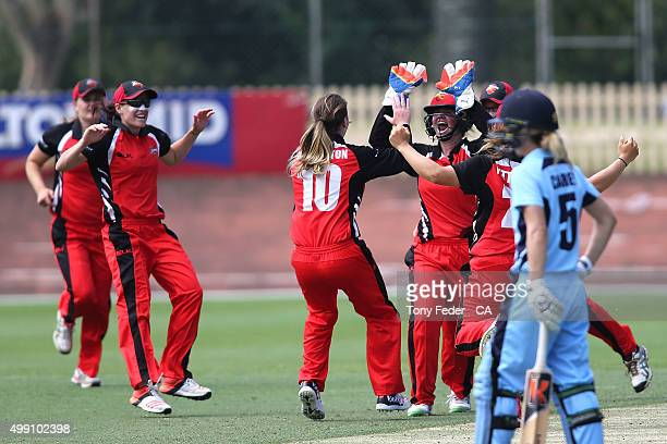 Scorpions celebrate the wicket of Laura Marsh of NSW Breakers during the WNCL Final match between the New South Wales and South Australia at...