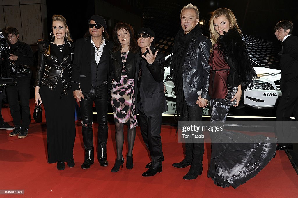 Scorpions' Matthias Jabs and wife Beate, Klaus Meine and wife Gaby, Rudolf Schenker and wife Tatjana attend the GQ Men Of The Year 2010 award ceremony at Komische Oper on October 29, 2010 in Berlin, Germany.