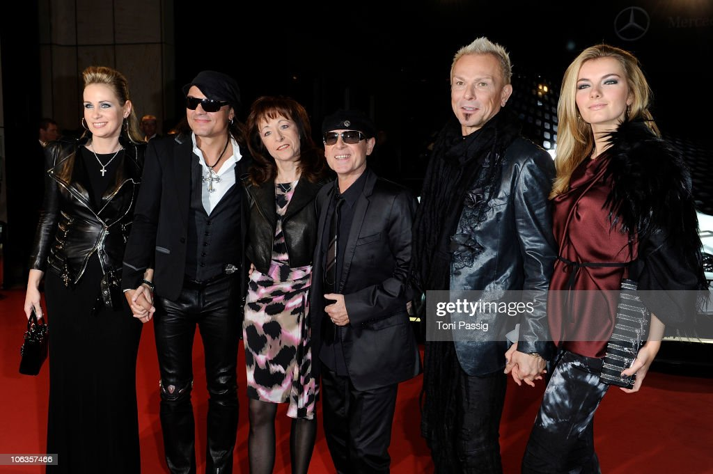 Scorpions' Matthias Jabs and wife Beate, <a gi-track='captionPersonalityLinkClicked' href=/galleries/search?phrase=Klaus+Meine&family=editorial&specificpeople=240345 ng-click='$event.stopPropagation()'>Klaus Meine</a> and wife Gaby, <a gi-track='captionPersonalityLinkClicked' href=/galleries/search?phrase=Rudolf+Schenker&family=editorial&specificpeople=710263 ng-click='$event.stopPropagation()'>Rudolf Schenker</a> and wife Tatjana attend the GQ Men Of The Year 2010 award ceremony at Komische Oper on October 29, 2010 in Berlin, Germany.
