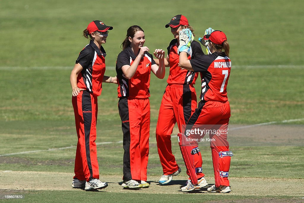 Scorpions players celebrate after getting the wicket of Rachael Haynes of the Breakers during the women's Twenty20 match between the South Australia Scorpions and the New South Wales Breakers at Prospect Oval on December 21, 2012 in Adelaide, Australia.