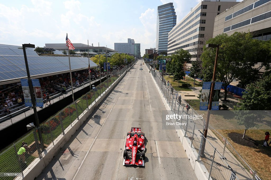 Scot Dixon, driver of the #9 Target Chip Ganassi Racing Honda Dallara leads the field down the front stretch during the Grand Prix of Baltimore on September 1, 2013 in Baltimore, Maryland.