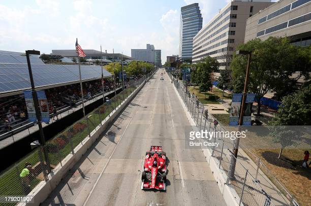 Scot Dixon driver of the Target Chip Ganassi Racing Honda Dallara leads the field down the front stretch during the Grand Prix of Baltimore on...