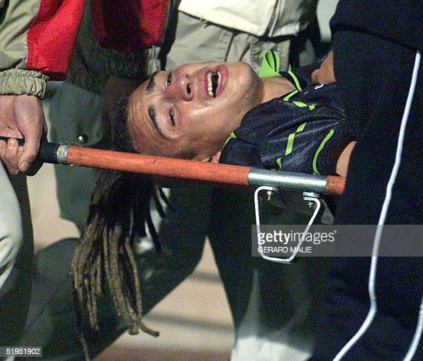Scot Henrik Larsson is evacuated on a stretcher after breaking his leg in a UEFA Cup match beteen the Glasgow Celtics and Olympic of Lyons in Gerland...