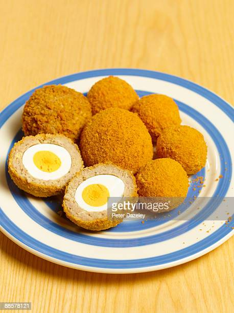 Scotch eggs on plate.