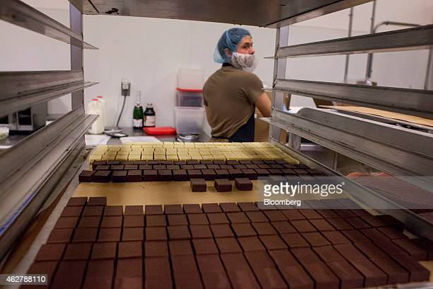 Scotch flavored chocolate pieces wait for preparation in the confection kitchen at the Theo Chocolate factory in Seattle Washington US on Monday Feb...