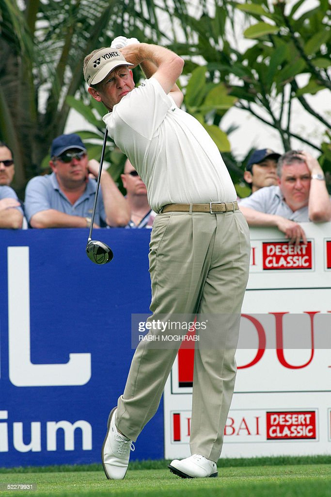 Scotch golfer Colin Montgomerie watches his drive in the 10th tee during the third round of the Dubai Desert Classic golf tournament 05 March 2005.