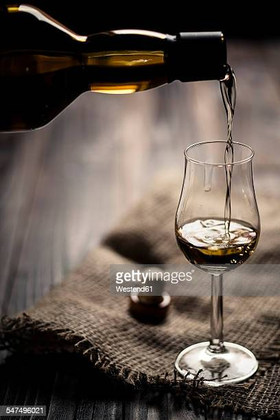 Scotch single malt whiskey being poured into nosing glass