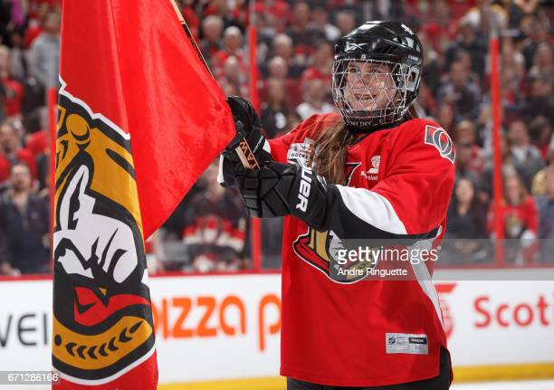 Scotiabank skater smiles during the singing of the national anthems prior to a game between the Ottawa Senators and the Boston Bruins in Game Five of...