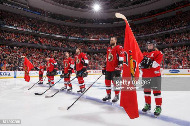 Scotiabank Skater stands at attention along with Dion Phaneuf Erik Karlsson Bobby Ryan and Viktor Stalberg of the Ottawa Senators during the singing...