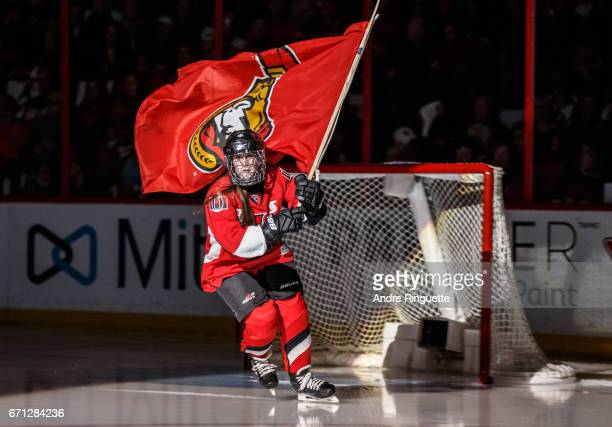 Scotiabank skater takes to the ice carrying a flag during player introductions prior to the Ottawa Senators playing against the Boston Bruins in Game...