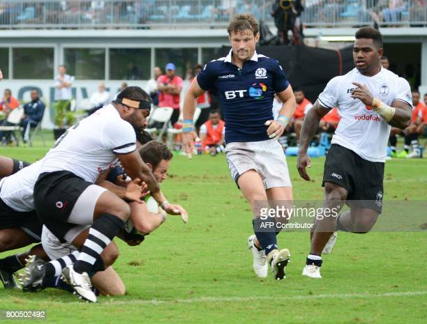 Scotish Ross Ford drives through the Fiji defence to score a try during their oneoff Test in Suva on June 24 2017 / AFP PHOTO / Ivamere Rokovesa