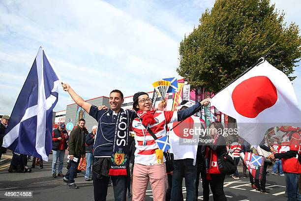 Scotland and a Japan fan fly the flag prior to the 2015 Rugby World Cup Pool B match between Scotland and Japan at Kingsholm Stadium on September 23...