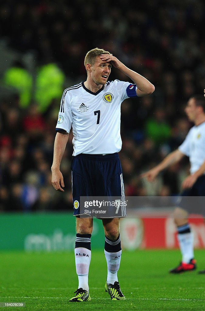 Scotland captain <a gi-track='captionPersonalityLinkClicked' href=/galleries/search?phrase=Darren+Fletcher&family=editorial&specificpeople=171310 ng-click='$event.stopPropagation()'>Darren Fletcher</a> reacts during the FIFA 2014 World Cup Qualifier Group A match between Wales and Scotland at Cardiff City Stadium on October 12, 2012 in Cardiff, Wales.
