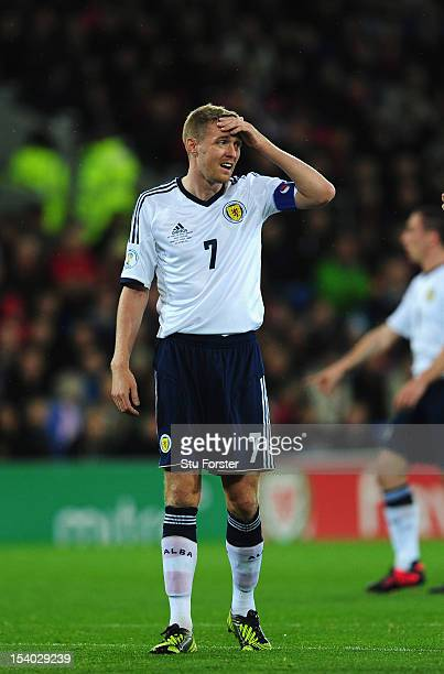 Scotland captain Darren Fletcher reacts during the FIFA 2014 World Cup Qualifier Group A match between Wales and Scotland at Cardiff City Stadium on...