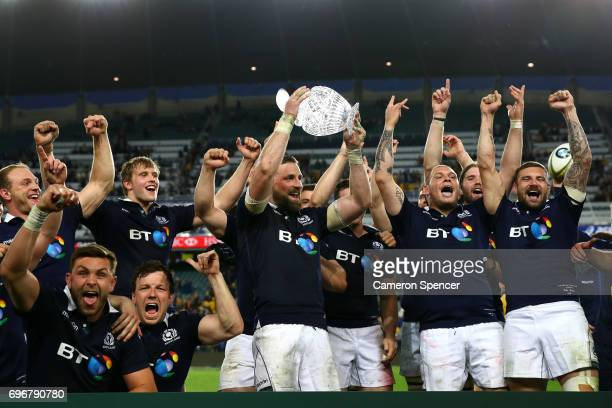 Scotland captain John Barclay celebrates with team mates after winning the Hopetoun Cup during the International Test match between the Australian...