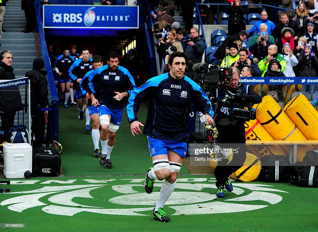 Scotland captain Kelly Brown leads out his team during the RBS Six Nations match between Scotland and Italy at Murrayfield Stadium on February 9, 2013 in Edinburgh, Scotland.