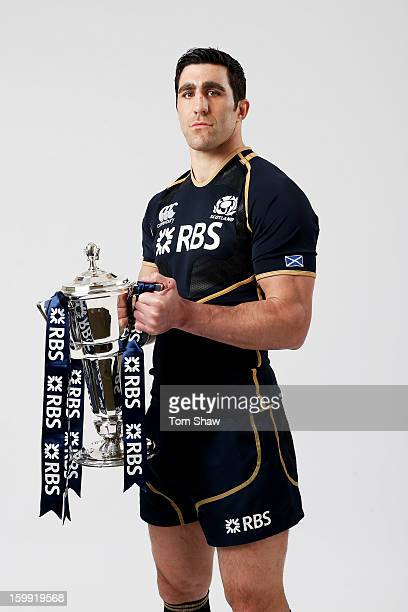 Scotland captain Kelly Brown poses with the Six Nations trophy during the RBS Six Nations launch at The Hurlingham Club on January 23 2013 in London...
