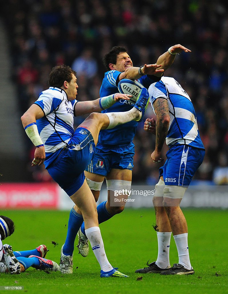Scotland centre Sean Lamont has his kick charged down by Alessandro Zanni of Italy during the RBS Six Nations match between Scotland and Italy at Murrayfield Stadium in Scotland, United Kingdom