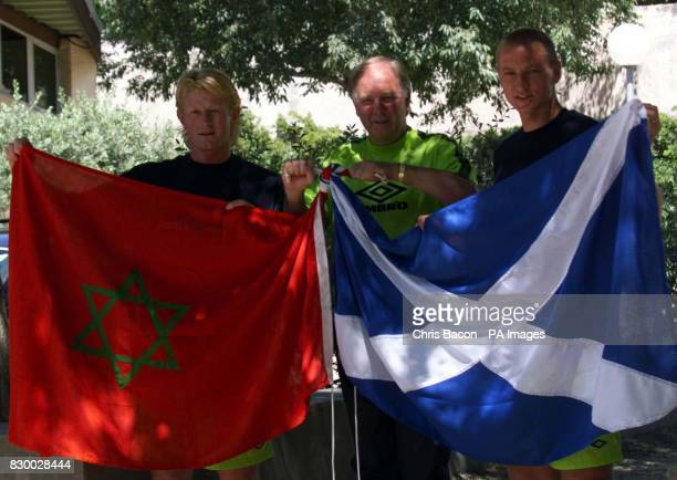 Scotland coach Craig Brown with team captain Colin Hendrey and teammate Matt Elliot holding the Scottish flag entwined with that of their next...
