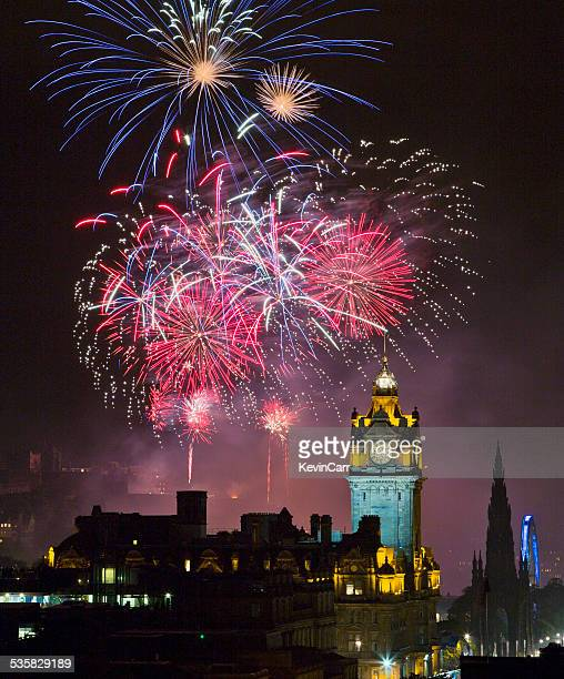 UK, Scotland, Edinburgh, Fireworks exploding above illuminated Edinburgh Castle during Edinburgh Fringe Festival